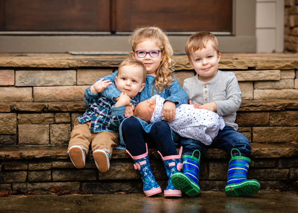 4 siblings together to a porch family photo session in raleigh