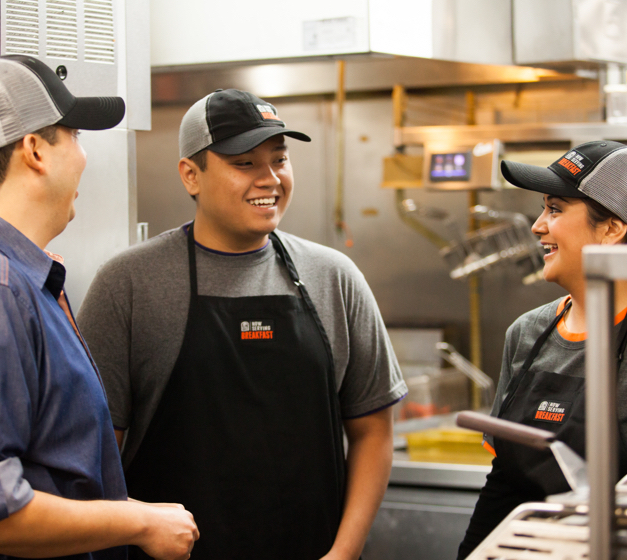Three employees laughing 1