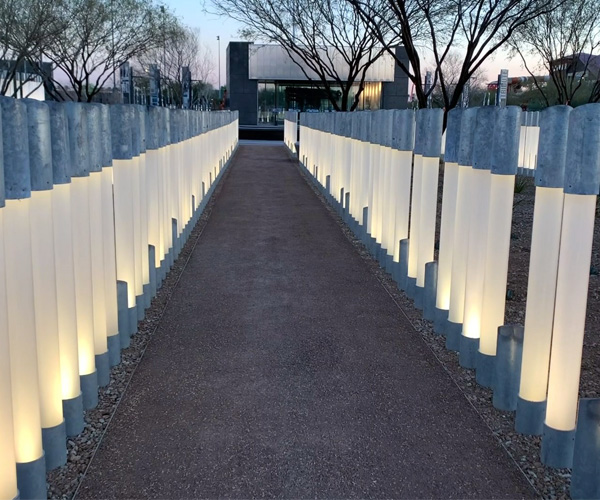 Poles lit up at dusk, each representing a life lost aboard the USS Arizona