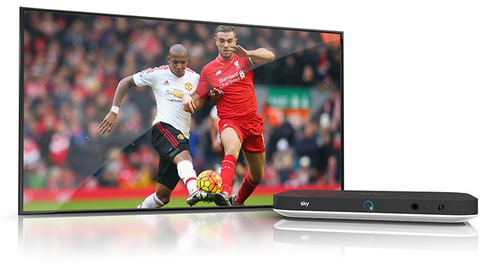 Image of Sky Q silver box alongside TV, showing Liverpool FC captain Jordan Henderson comfortably winning the ball using his strength, power and ability from Ashley Young.