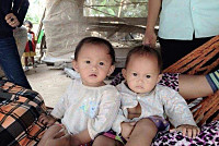 Putha .. Two twin girls slip into two...