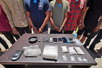Nearly two kilograms of drugs, along...