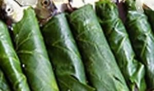 Sardines en papillotes de feuilles de vigne au barbecue, à la plancha
