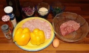 Poivrons farcis à l'échine de porc et mortadelle au four