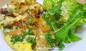 Omelette aux girolles et pommes de terre sautées à la graisse de canard et piment d'Espelette