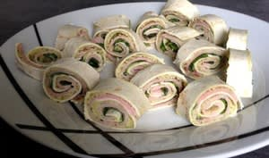 Mini wraps au pesto, jambon et roquette