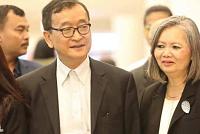 Mr. Rainsy and Mr Mu Sochua go to...