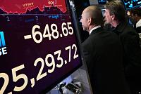 Fed Officials See Risks in Weaker...
