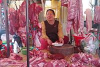 Pork traders at Chhbar Ampov market...