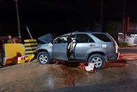 Journalist crashes car in headstone,...
