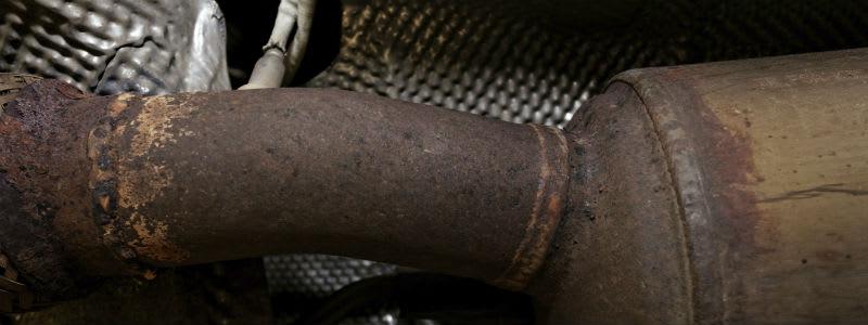 Rostig del av ett avgassystem