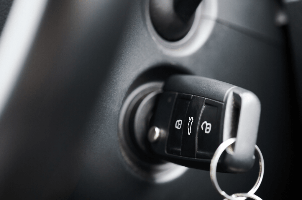 black car key in the ignition