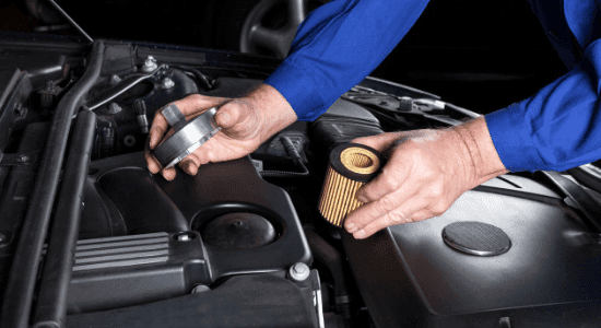 mechanic changing fuel filter