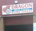 Dragon M O T Centre logo