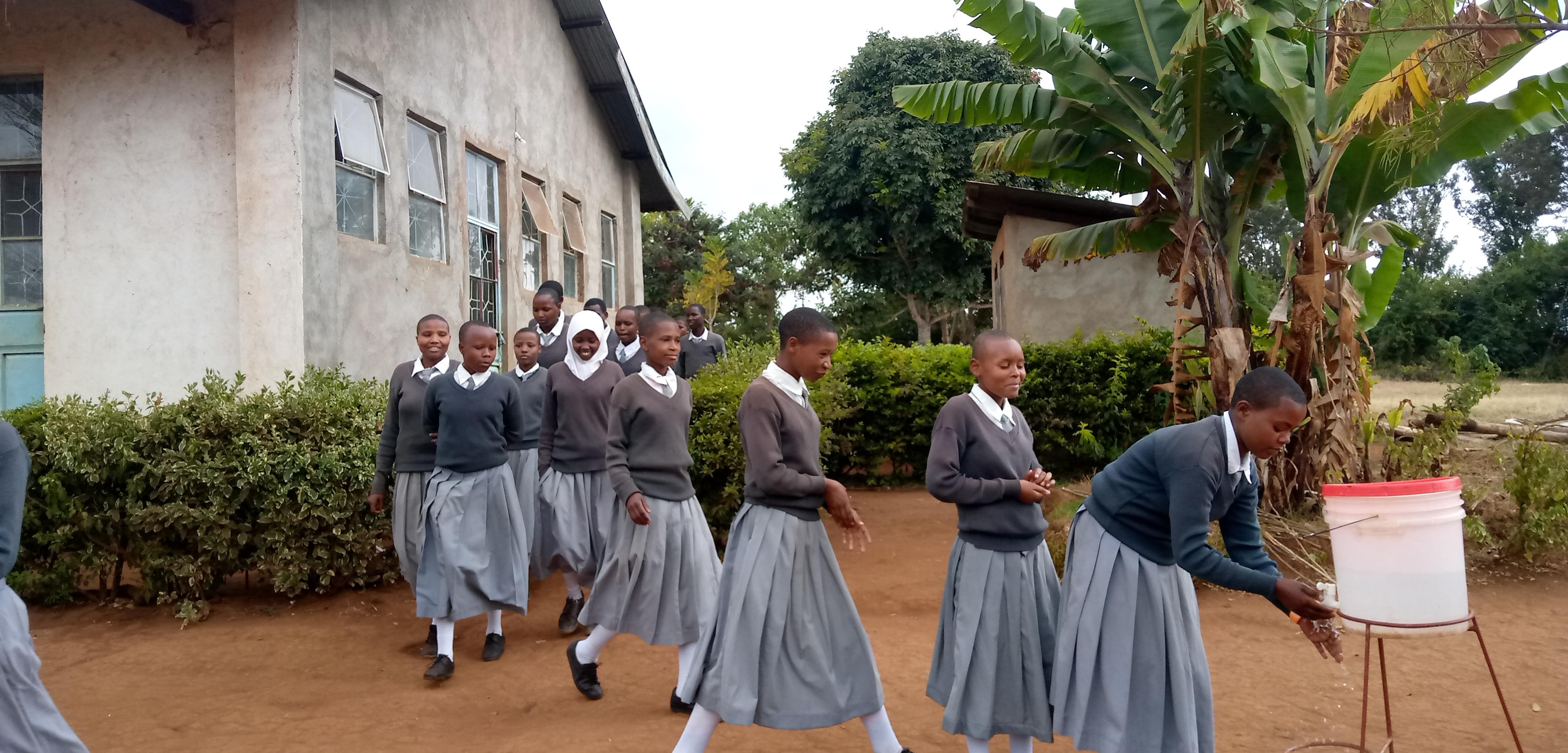 6.31 - Project 2021 - Tsaayho Secondary bathrooms - Students washing hands after bathroom use 01.jpg