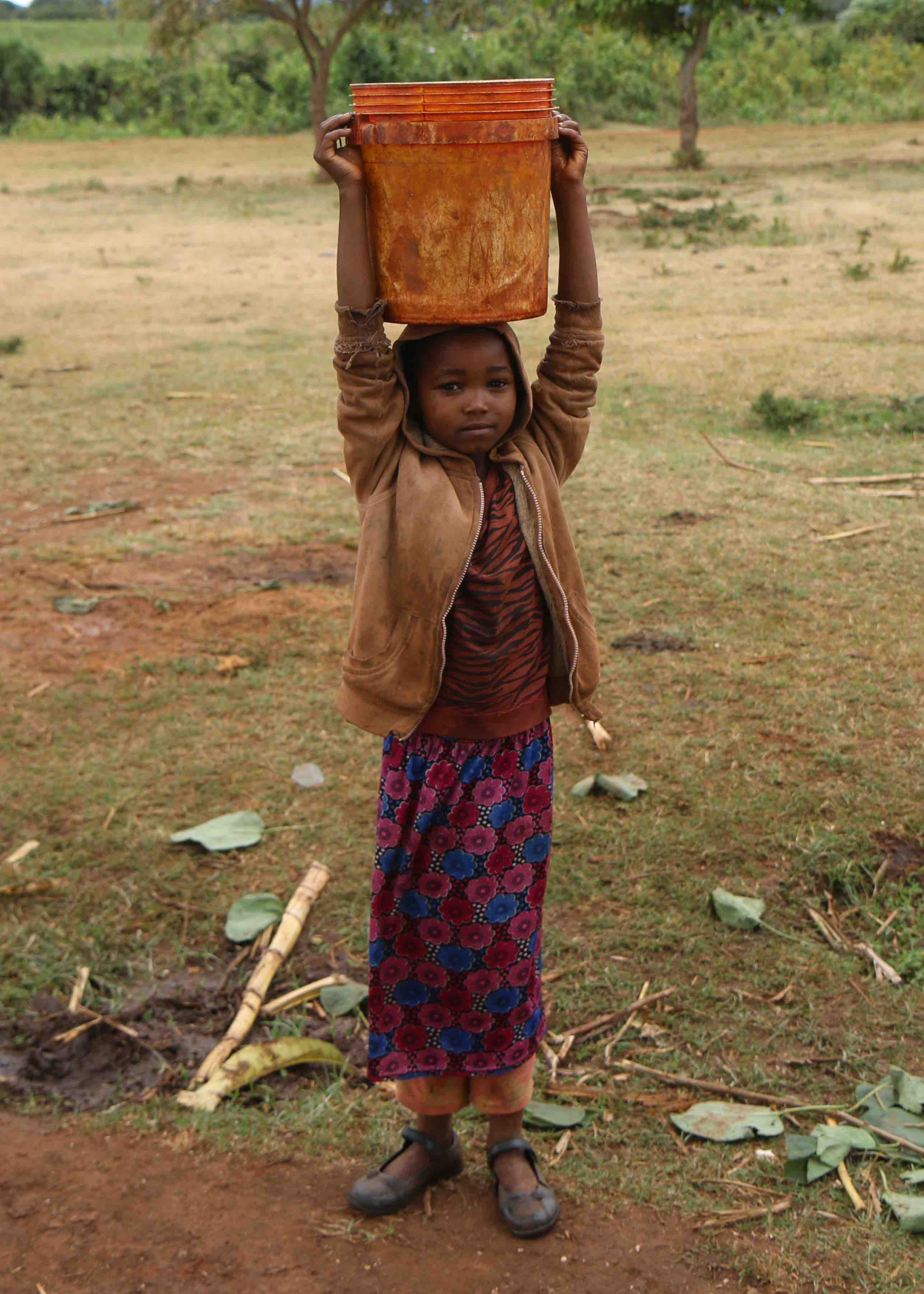 6.2 Project 2018 -  Girl carrying water.jpg