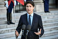 Two Canadians arrested for acting on...