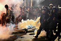 6 dead and 200 wounded in protests in...