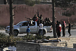 US Sanctions Turkey, Seeks Halt to...