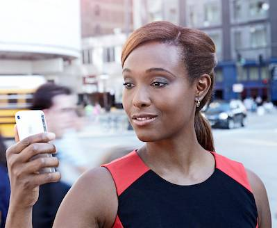 Woman holding a mobile device