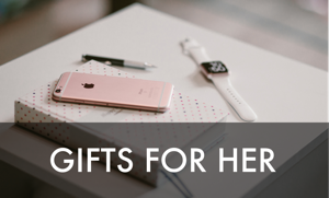 Gifts for her, showing a phone, watch, and journal with a pen.