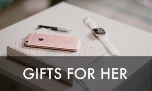 携帯電話、腕時計、日記帳とペンを含む女性用ギフト。