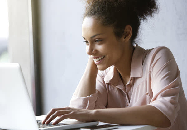 Happy woman using a computer