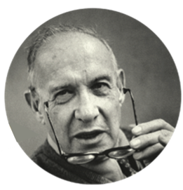 Photo of Peter Drucker holding his glasses
