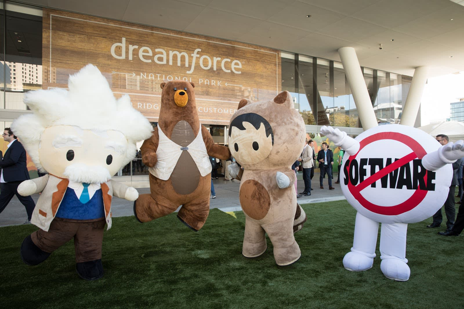 Einstein, Codey, Astro, and SaaSy - Salesforce Characters jumping for joy.