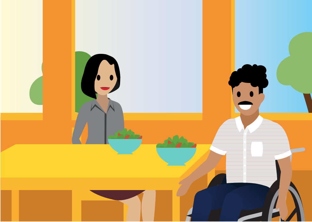 People sitting at a table, eating a salad.