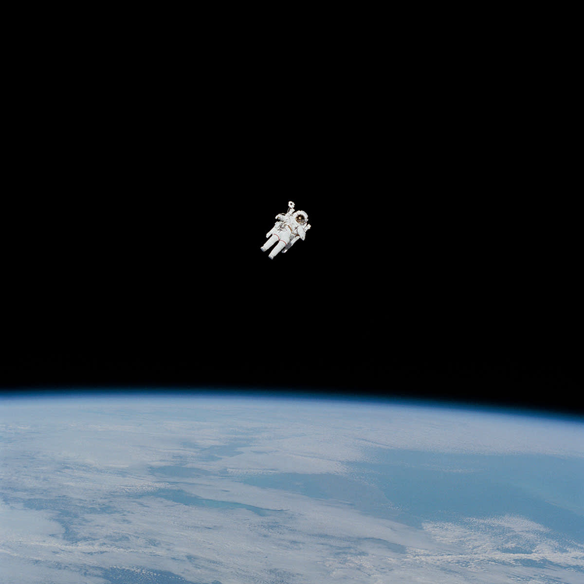 Photo of spacewalker floating above the earth