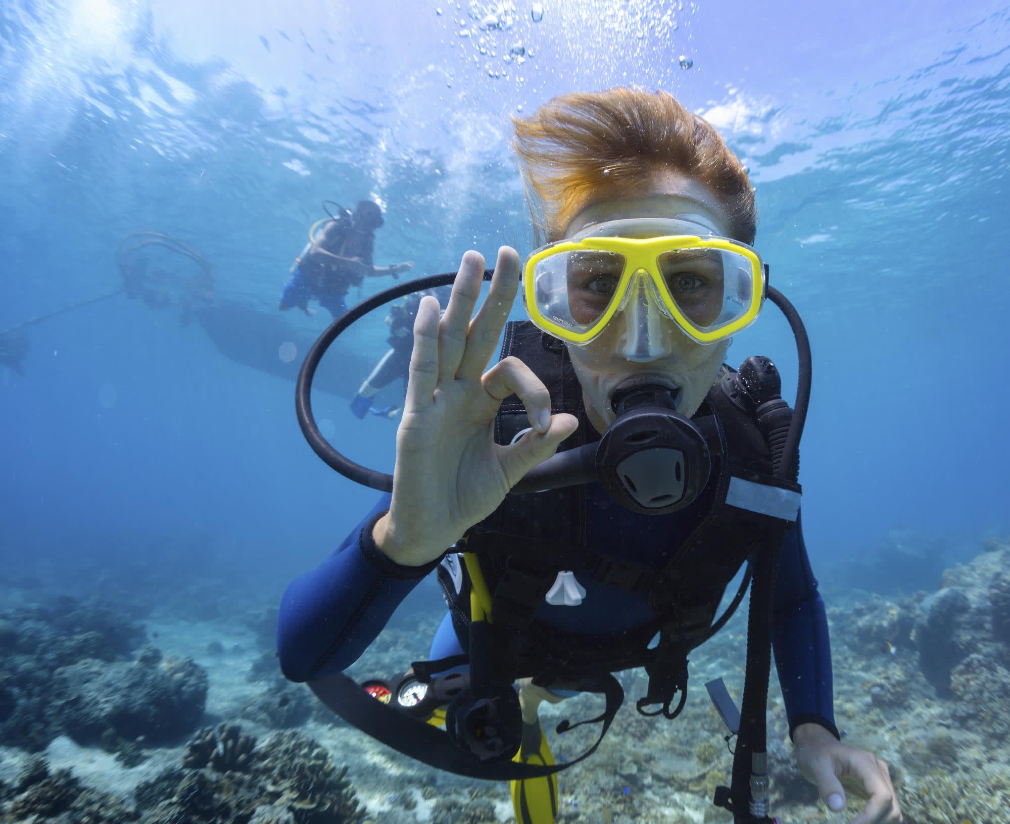 SCUBA diver signaling OK