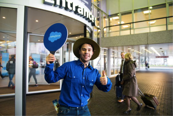 A man at Dreamforce with a Salesforce squash paddle