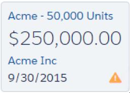 アラートアイコンが表示されている Acme - 50,0000 Units 商談カード。