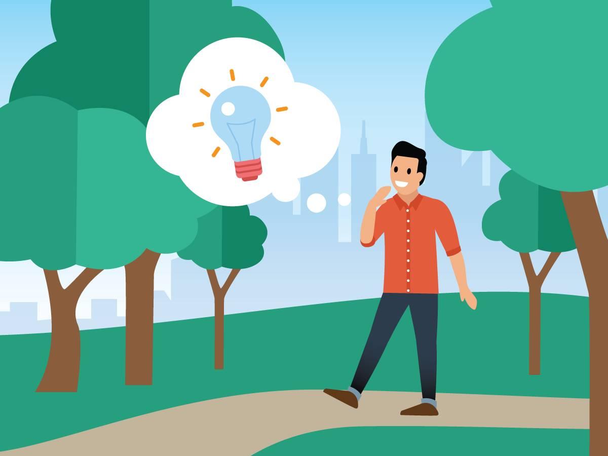 公園の中を歩いている好奇心のある男性がアイデアを思いつく