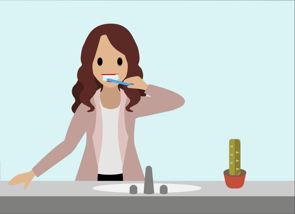 Person, die sich die Zähne putzt.