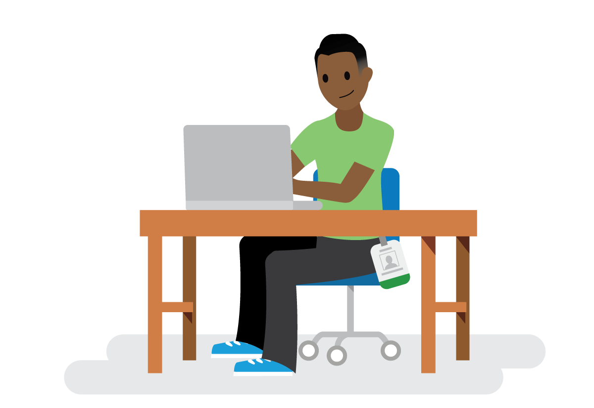 Salesforcelandian sitting at a desk in front of a computer.