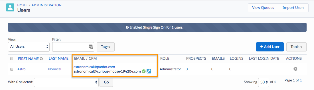 Users page, showing a green checkmark and blue wrench next to the user record signifying SSO is successfully enabled