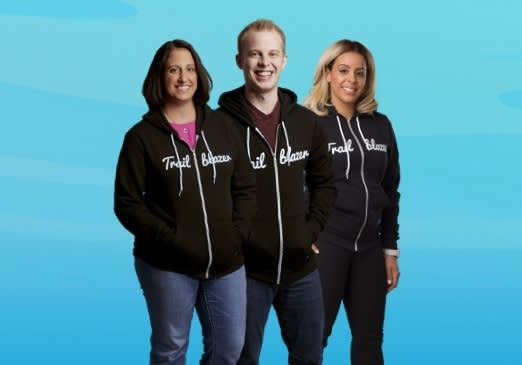 Image of 3 people with their Trailblazer hoodies