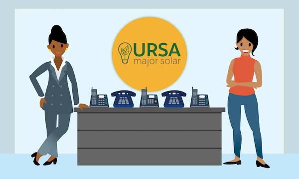Sita and Maria standing alongside the Ursa Major Solar logo.