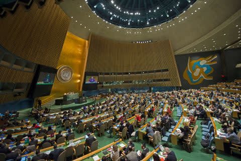 Wide view of the UN General Assembly Hall with a session in progress