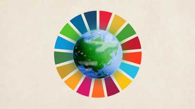 Cartoon of Earth surrounded by a wheel of colours representing the sustainable development goals.