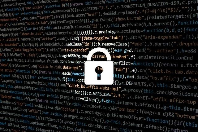 Padlock over a screen of computer code