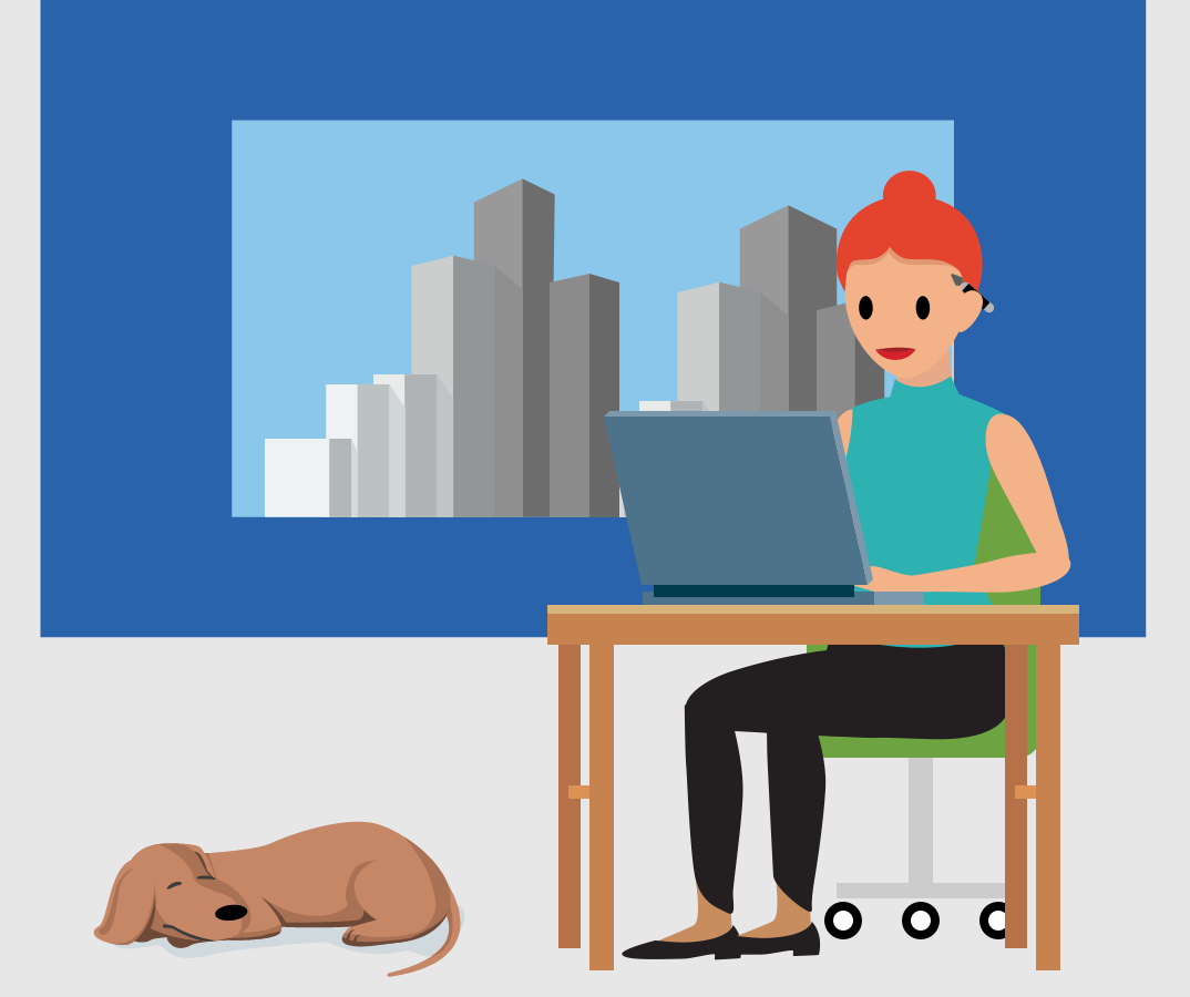image of researcher seated at desk working on laptop with dog lying on the floor