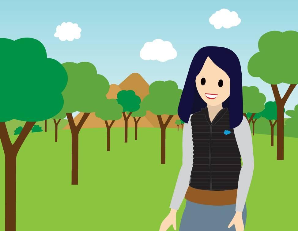 Eine Frau, die unter Bäumen spazieren geht.