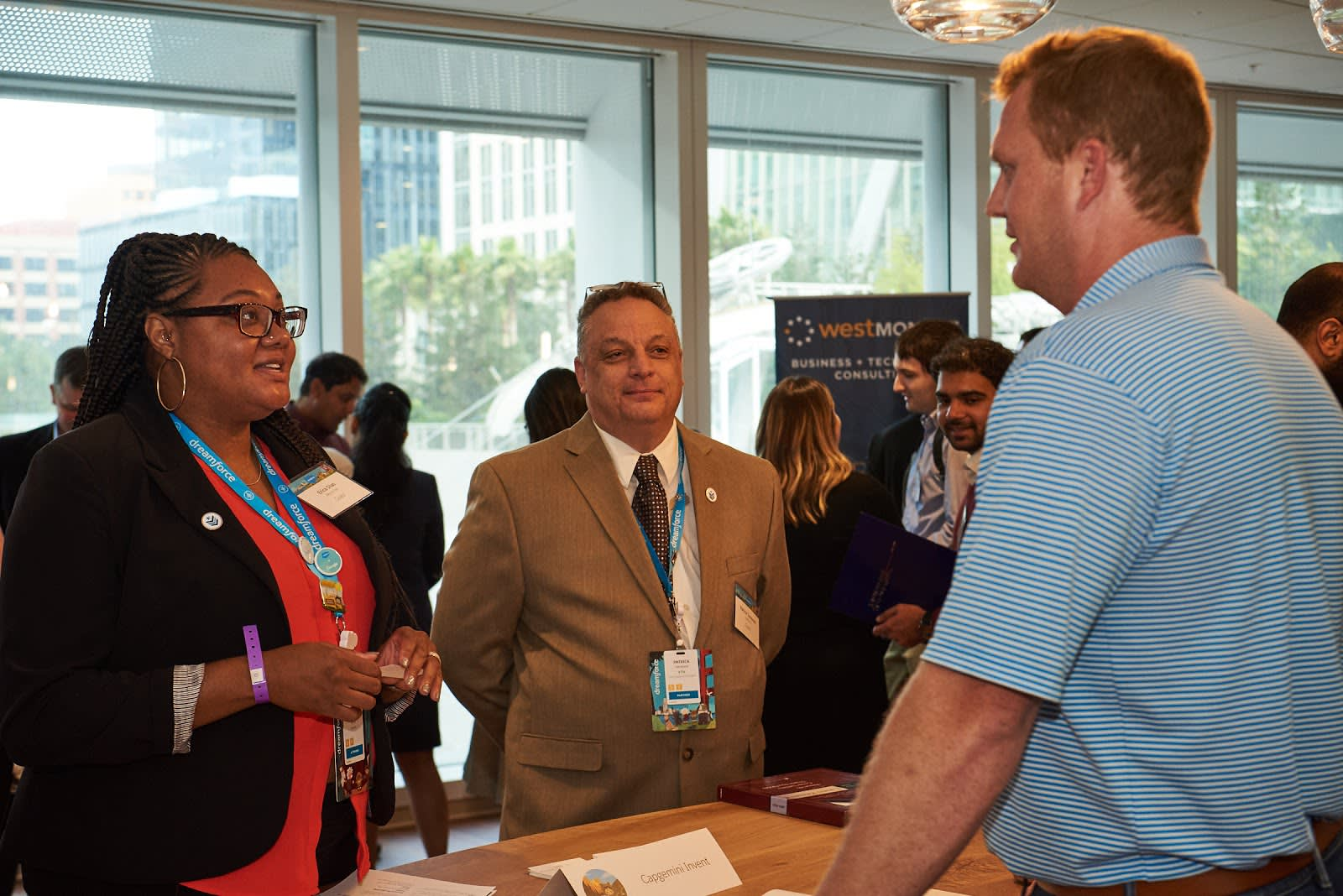 Alt text: Three people meeting at a Vetforce recruitment event.