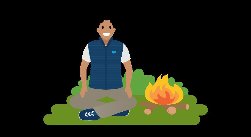 Image d'un employé assis près d'un feu de camp.