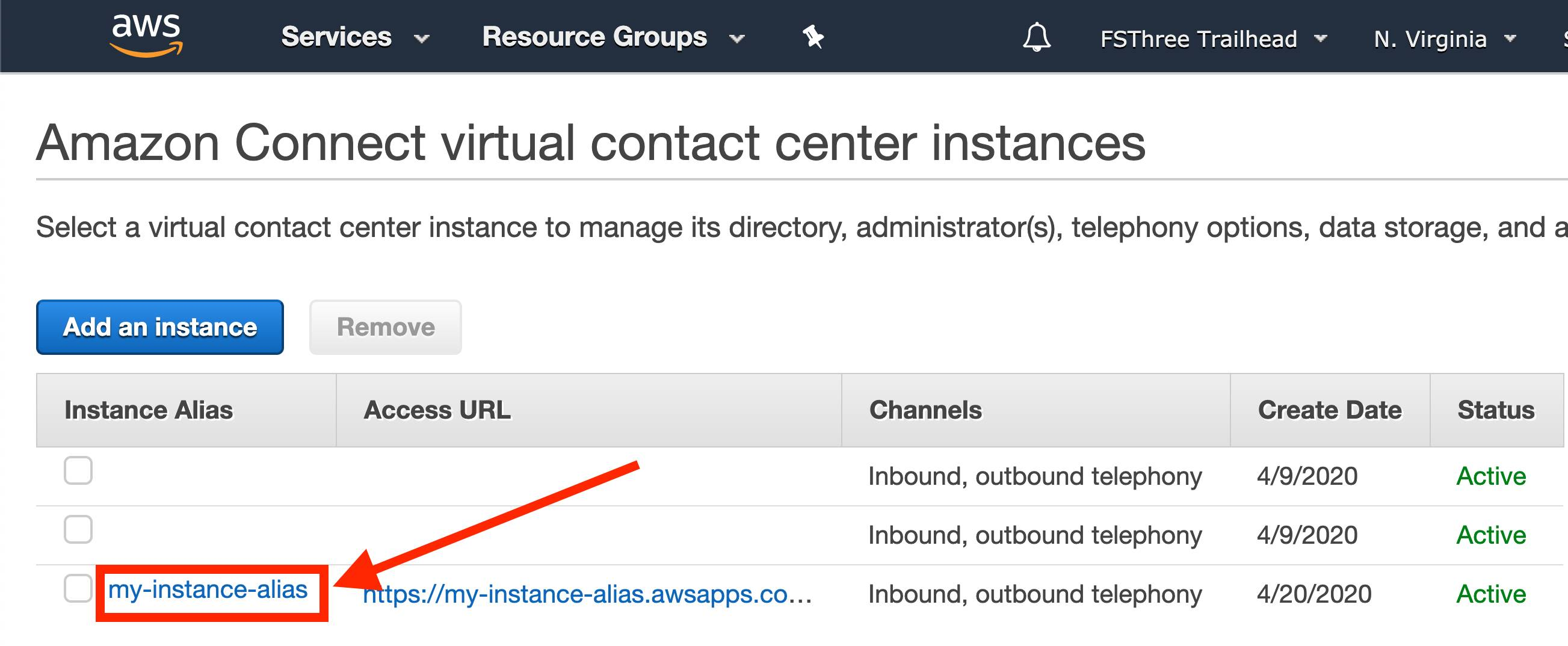 Amazon Connect console with instance alias highlighted by a red box and arrow
