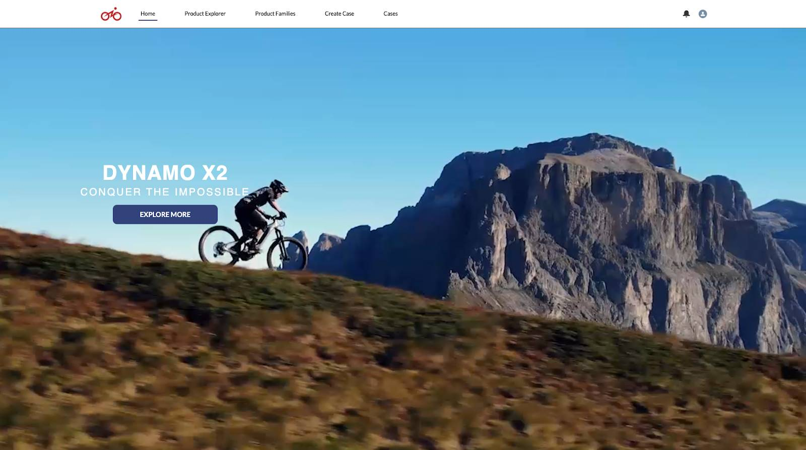 E-Bikes Community home page showing a man riding a bike through the mountainside. There's an Explore More call-to-action button under the brand tagline.