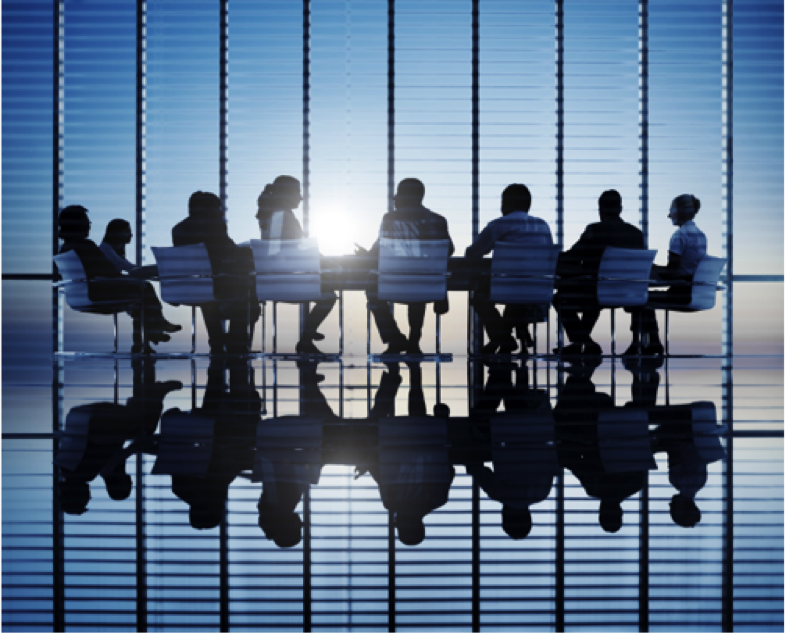 Business partners sitting around a table in a sunlit room
